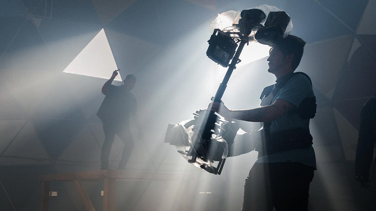 Behind the scenes image of a steadicam operator.